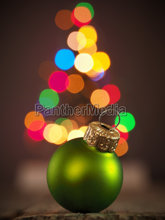 christmas background with green christmas bauble