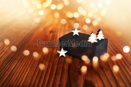 christmas gift with golden bokeh