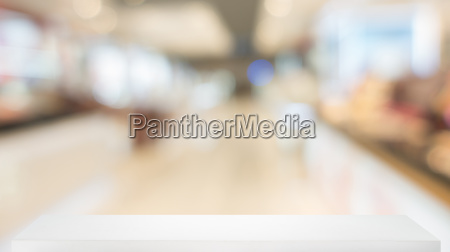 defocused convenience store with wooden shelf