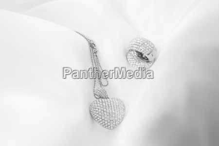 white gold earrings and heart shaped