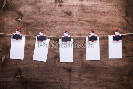 paper tags hanging on a rope