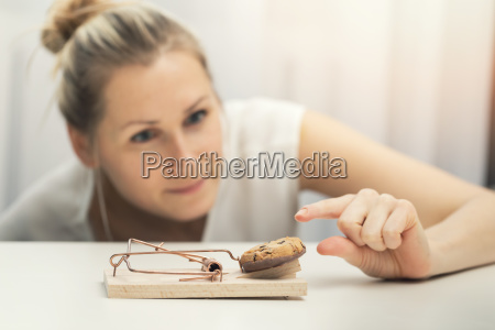 hungry woman trying to steal cookie