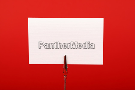 blank white paper sign over red