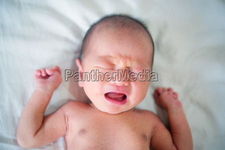 asian newborn baby boy crying