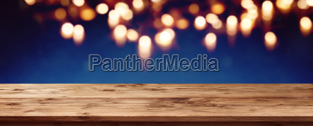 blue bokeh background with wooden table