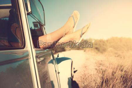 girls legs in a car