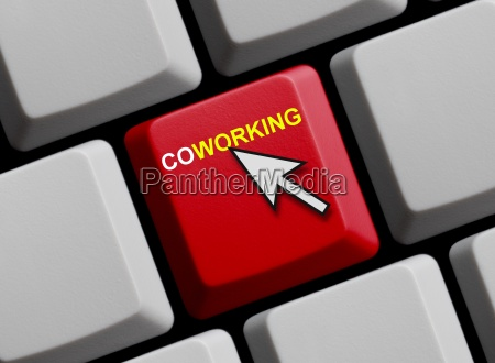 coworking on red computer keyboard
