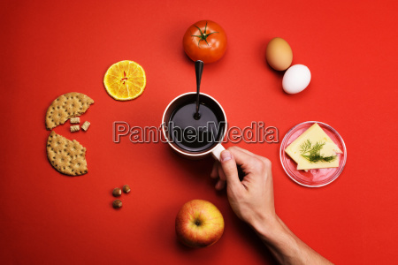 man, holding, a, cup, of, coffee - 23448213