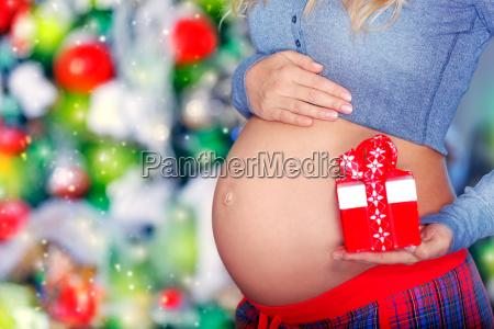 pregnant, woman, with, christmas, gift - 23448997