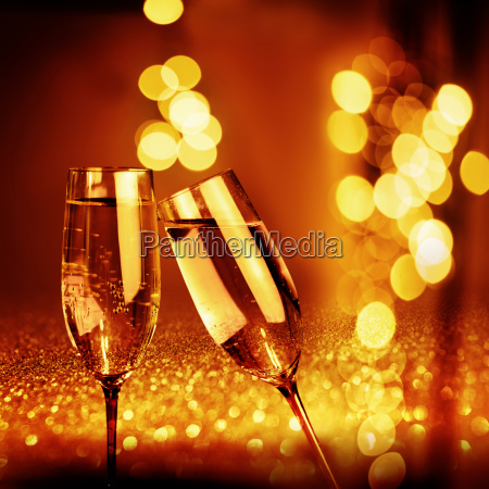 golden glowing bokeh background with champagne