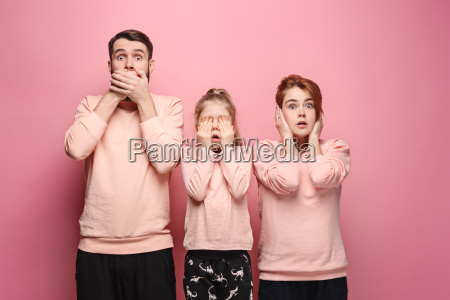 surprised, young, family, looking, at, camera - 23452645