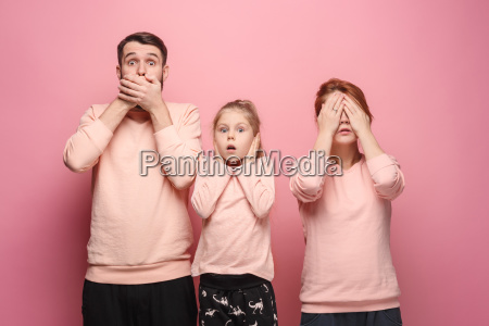 surprised, young, family, looking, at, camera - 23452647