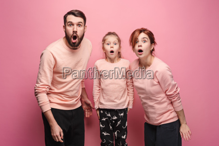 surprised, young, family, looking, at, camera - 23452691