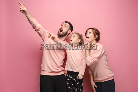 surprised, young, family, on, pink - 23452657