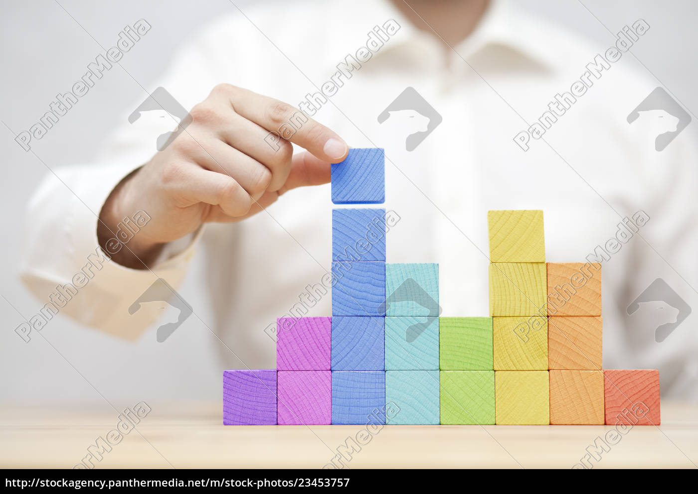 man's, hand, stacking, colorful, wooden, blocks. - 23453757