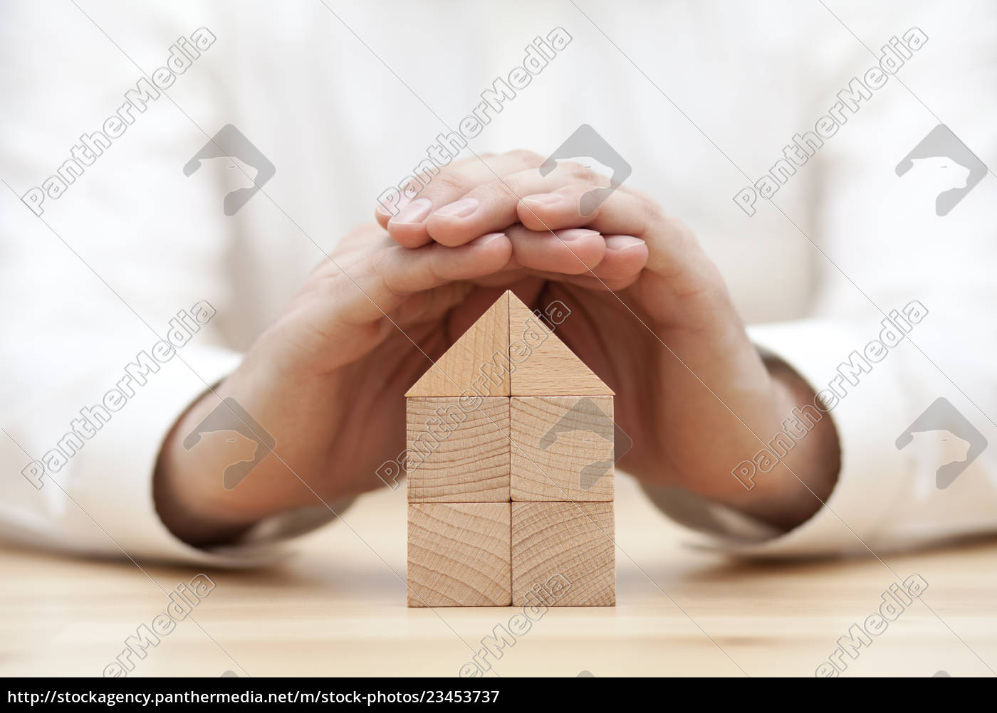 wooden, block, house, protected, by, hands - 23453737