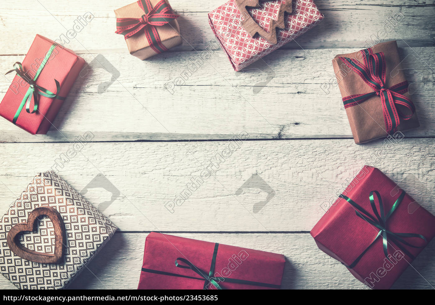 wrapped, christmas, gifts, on, wooden, background - 23453685