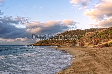 beach lu bagnu mountains mediterranean coast