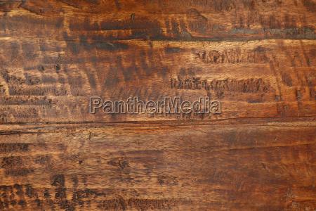 grunge background texture of brown woodgrain