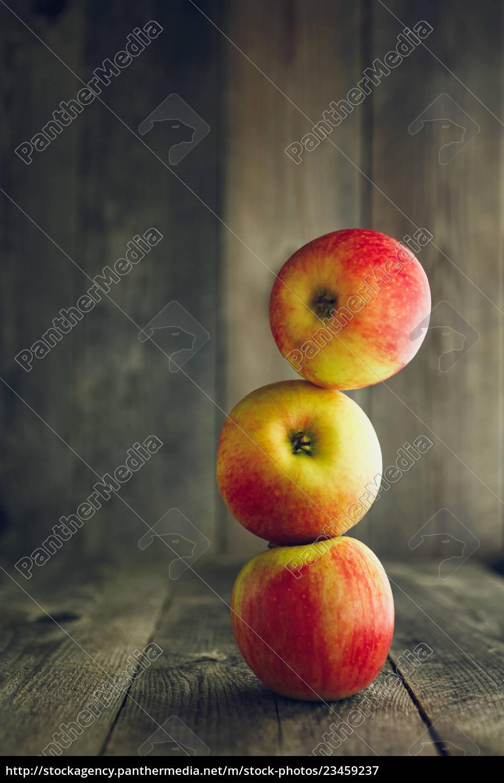 balance., three, red, apples, one, on - 23459237