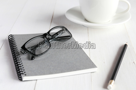 business accessories on white wooden table