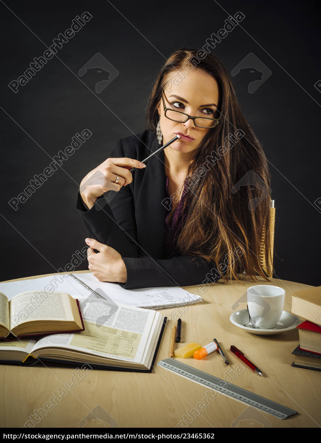 woman, sitting, at, her, desk, thinking - 23465362