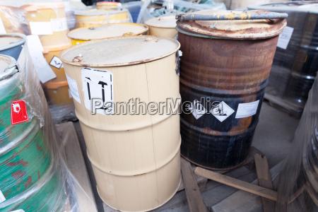 chemical waste dumped in rusty barrels