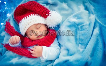 cute, baby, boy, sleeping, in, santa - 23474147