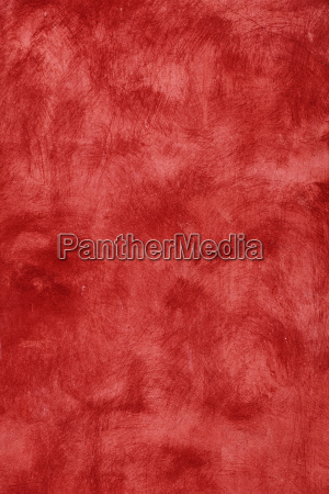 grunge red painted plaster wall background