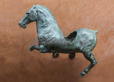 roman figure of wounded galloping horse