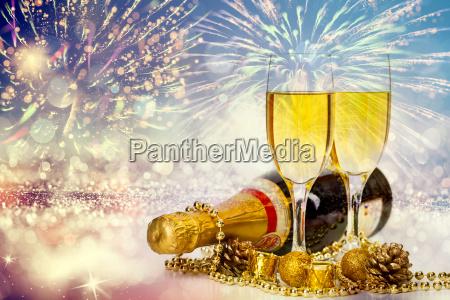 champagne glasses on sparkling background