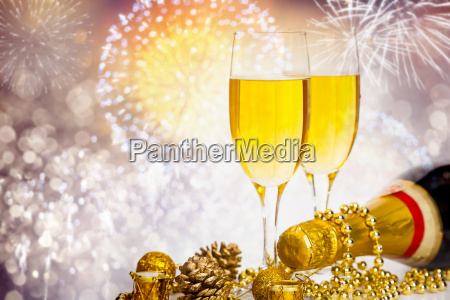champagne glasses on sparkling background
