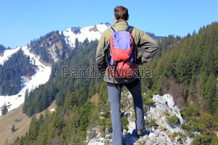 hikers look to the mountain peak