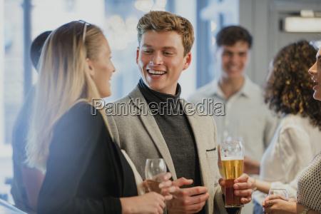 businesspeople, enjoying, after-work, drinks - 23509216