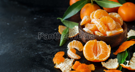 mandarins with leaves in a bowl