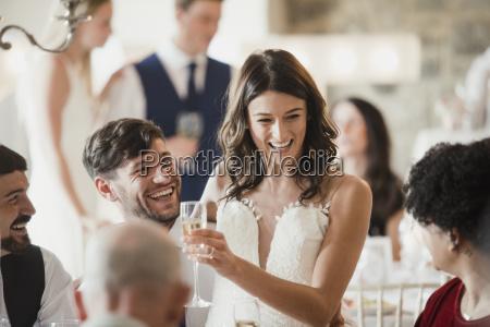 happy bride and groom are socialising
