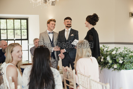 two, men, exchanging, vows, on, their - 23516762