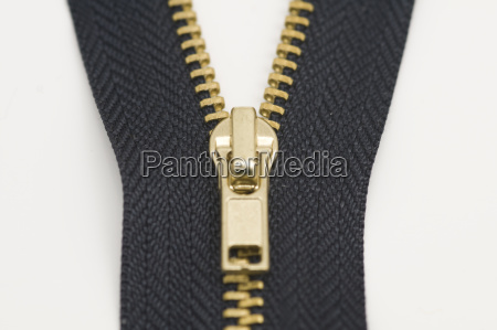 a zipper on a white surface
