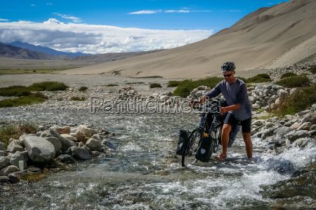 cyclist crossing the river