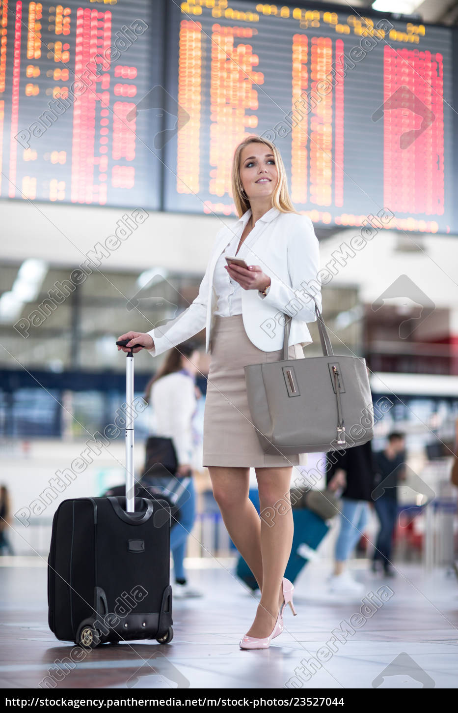 young, female, passenger, at, the, airport, - 23527044