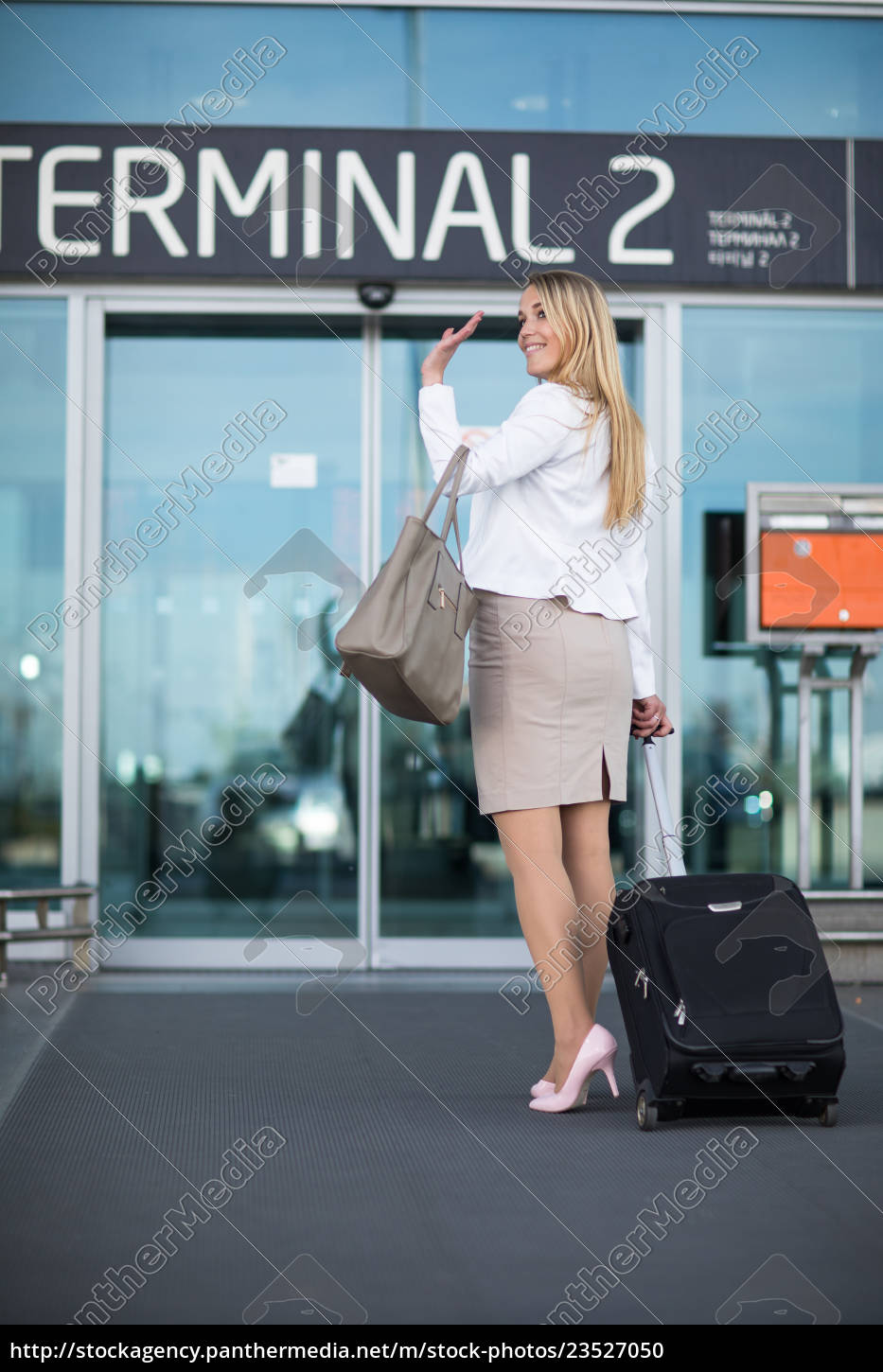 young, female, passenger, at, the, airport, - 23527050