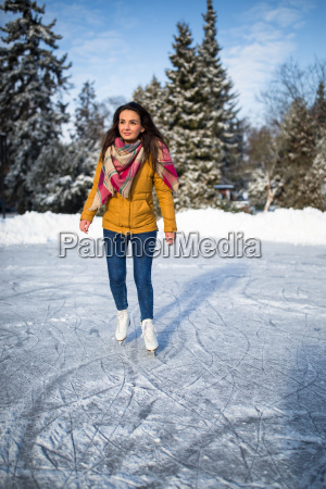 young, woman, ice, skating, outdoors, on - 23527070