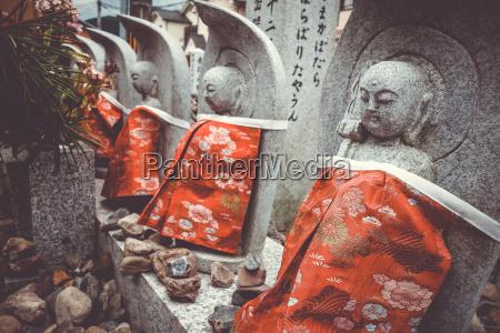 jizo statues in arashiyama temple kyoto