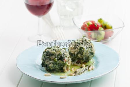 two italian strangolapreti spinach dumplings