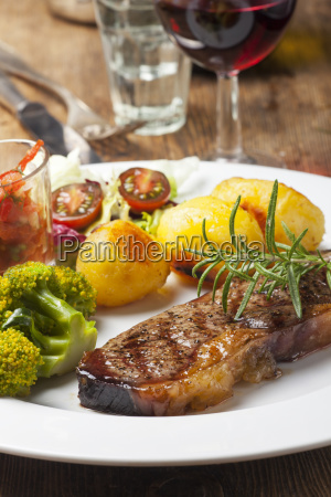 grilled steak with vegetables and wine