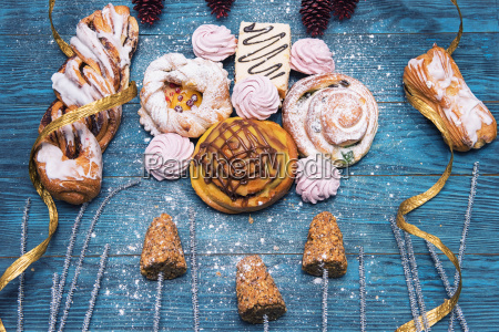 different, cookies, on, blue, wooden - 23544160