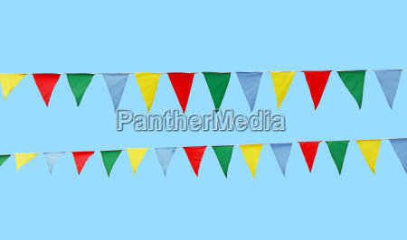 multicolor festive flags isolated over blue