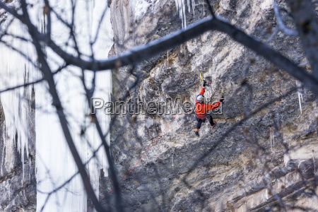 rear view of man ice climbing