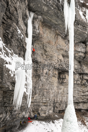 man rock climbing on wall covered