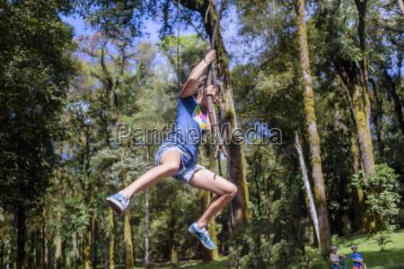 woman swinging on liana bedugul bali